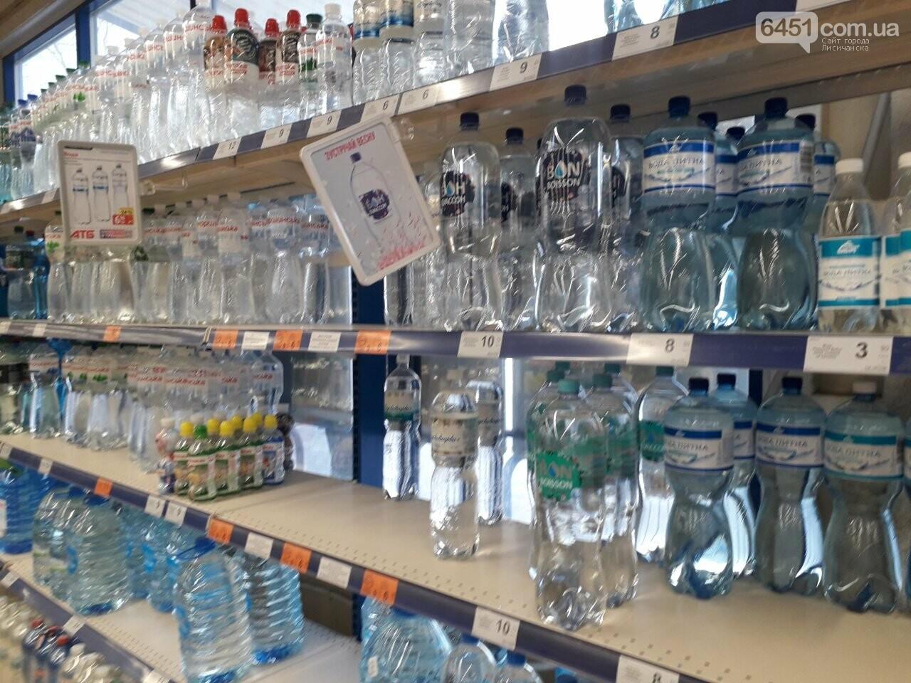 Ажиотажа нет, но продукты раскупают: что происходит в супермаркетах Лисичанска накануне карантина (фоторепортаж), фото-15